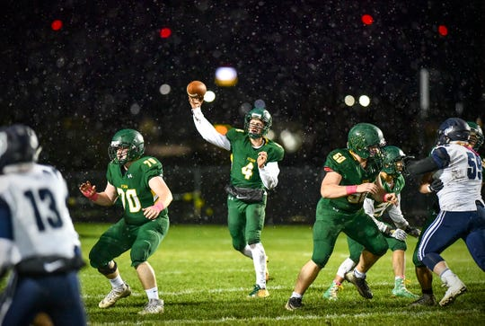 Quarterback Kobe Lee throws a pass during the first half of the Friday, Oct. 11, 2019, game against Bemidji in Sauk Rapids.