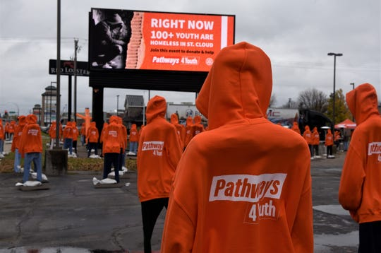A group of more than 100 mannequins represent youth experiencing homelessness in Central Minnesota on Saturday, Oct. 12, 2019 along Minnesota Highway 23 in St. Cloud.