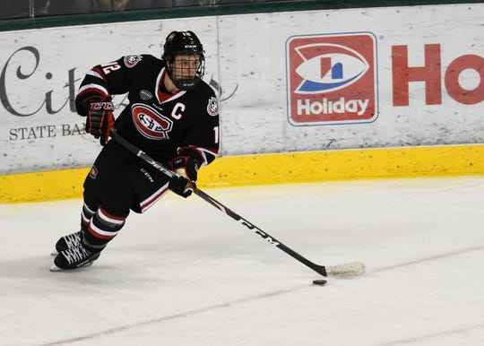 St. Cloud State senior captain Jack Ahcan looks for open ice in the Huskies nonconference game against Bemidji State on Friday.