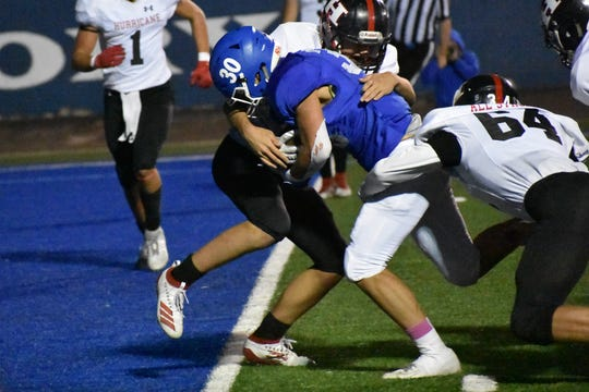 Dixie's Alex Maycock scores on a short run against Hurrcane.