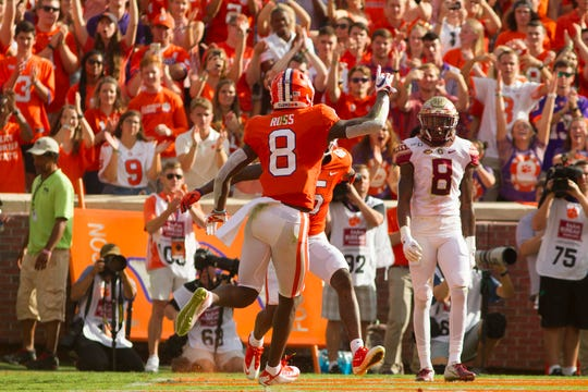 Oct 12, 2019; Clemson, SC, USA; Clemson Tigers Justin Ross (8) celebrates after scoring a touchdown during the first half of the game against the Florida State Seminoles at Clemson Memorial Stadium. Mandatory Credit: Joshua S. Kelly-USA TODAY Sports