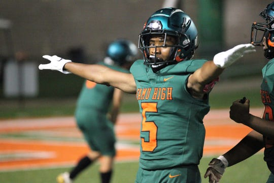 FAMU DRS defensive back Zaire Riley celebrates a turnover on downs as NFC beat FAMU DRS 14-12 at Bragg Memorial Stadium on Friday, Oct. 11, 2019.