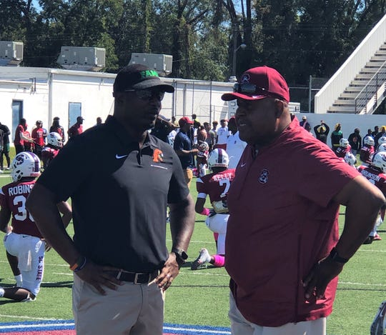 "Willie Simmons (left) talks with South Carolina State head coach Oliver ""Buddy"" Pough during pregame of the Rattlers-Bulldogs contest in Orangeburg, South Carolina on Saturday, Oct. 12, 2019."