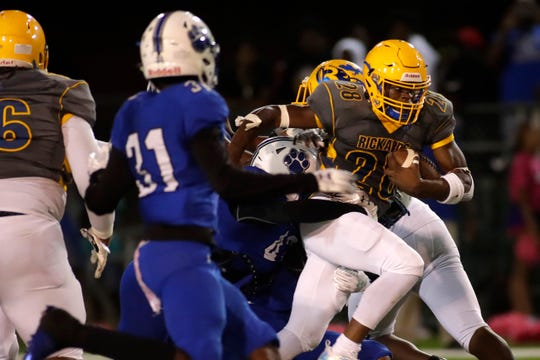 Rickards running back Devin Bailey (28) forces his way through the defense. The Cougars hosted the Raiders for their 2019 homecoming football game at Gene Cox Stadium, Friday, Oct. 11, 2019.