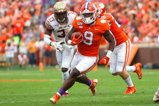 Oct 12, 2019; Clemson, SC, USA; Clemson Tigers running back Travis Etienne (9) carries the ball during the first quarter of the game against the Florida State Seminoles at Clemson Memorial Stadium. Mandatory Credit: Joshua S. Kelly-USA TODAY Sports