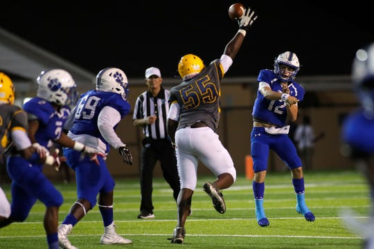 Rickards Raiders defensive end Preston Loggins (55) blocks the pass made by Godby Cougars quarterback Trey Fisher (12). The Cougars hosted the Raiders for their 2019 homecoming football game at Gene Cox Stadium, Friday, Oct. 11, 2019.