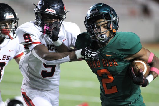 FAMU DRS senior LaKavian Williams tries to hold off NFC's Deandrae McCray as NFC beat FAMU DRS 14-12 at Bragg Memorial Stadium on Friday, Oct. 11, 2019.
