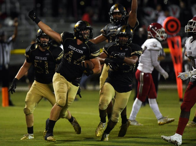 Treasure Coast High School's Keegan Davis celebrates a touchdown on Friday, Oct. 11, 2019, during a game against Vero Beach at the South County Regional Stadium in Port St. Lucie. Vero Beach won the game 31-30 in overtime.