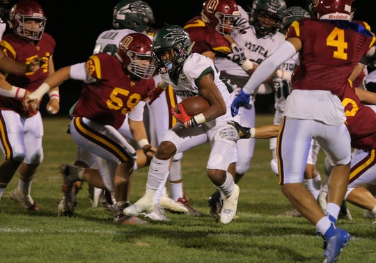 Pacifica High's Malik Sherrod finds an opening in the Oxnard defense during the first quarter of Friday night's showdown. Oxnard won, 36-27.