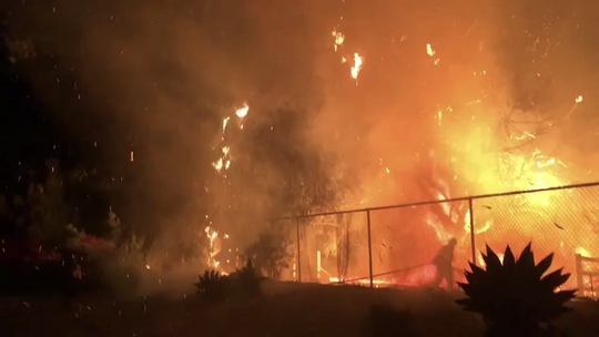 This still from video shows the Ridge View fire in southeast Camarillo late Friday.  Firefighters kept the blaze to a half acre as fire-prone weather conditions lingered in the region.