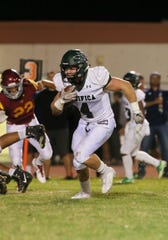Pacifica High's Brad Bichard finds some room to run en route to the Tritons' first touchdown during the first quarter of Friday night's game at Oxnard High. The Yellowjackets won 36-27.