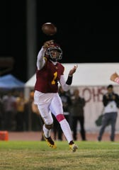 Oxnard High quarterback Jaden Jones fires a pass on the run during the Yellowjackets' 36-27 victory over Pacifica in a Pacific View League showdown Friday night.