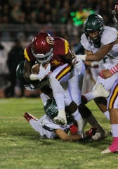 Xavier Harris, shown in a game against Pacifica, ran for 139 yards and two scores to help Oxnard beat Rio Mesa 38-7.
