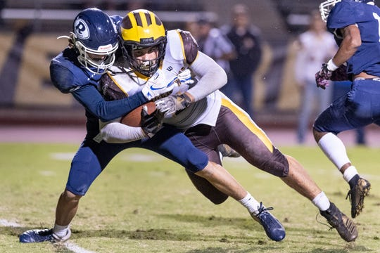 Golden West's Lonnie Wessel leans into Redwood's Mitchell Wilson in a West Yosemite League high school football game on Friday, October 11, 2019.