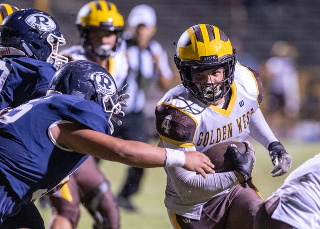 Golden West's Lonnie Wessel runs against Redwood in a West Yosemite League high school football game on Friday, October 11, 2019.