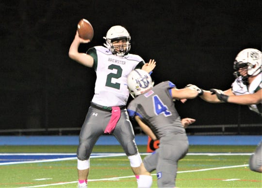 Brewster quarterback Chris Donohue prepares to throw as Hen Hud's Nick Renzi rushes him.