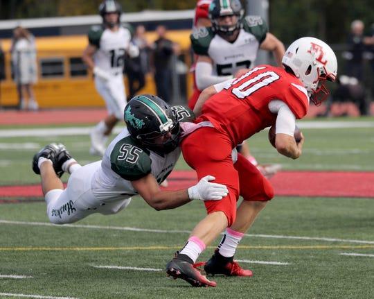 Yorktown's Eddie Capone tackles Fox Lane quarterback Spencer Rowley during Yorktown's 42-0 at Fox Lane High School in Bedford Oct. 12, 2019.