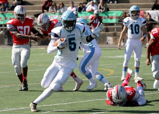Suffern ball carrier Clevmer Lubin carries the ball during their football game against the Yonkers Brave at Saunders High School in Yonkers, Oct. 12, 2019.