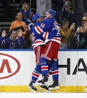 NEW YORK, NEW YORK - OCTOBER 12: Kaapo Kakko #24 of the New York Rangers celebrates his first NHL goal at 18:28 of the first period against the Edmonton Oilers as he is embraced by Ryan Strome #16 (L) at Madison Square Garden on October 12, 2019 in New York City. (Photo by Bruce Bennett/Getty Images)