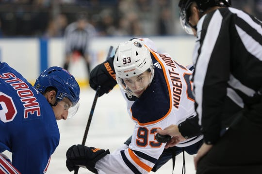 Oct 12, 2019; New York, NY, USA; Edmonton Oilers center Ryan Nugent-Hopkins (93) faces off against New York Rangers center Ryan Strome (16) during the third period at Madison Square Garden. Mandatory Credit: Vincent Carchietta-USA TODAY Sports