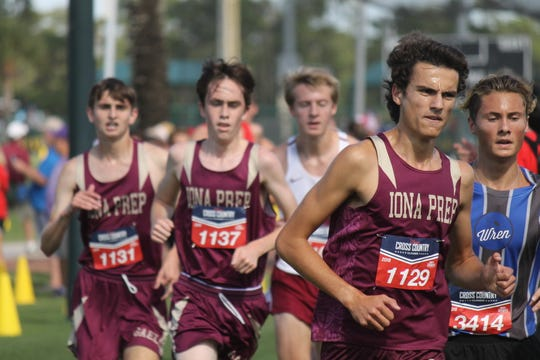 Pedro Bravo (r) of Iona Prep leads the pack before winning his race at the Oct. 12, 2019 Disney Cross Country Classic in Florida.