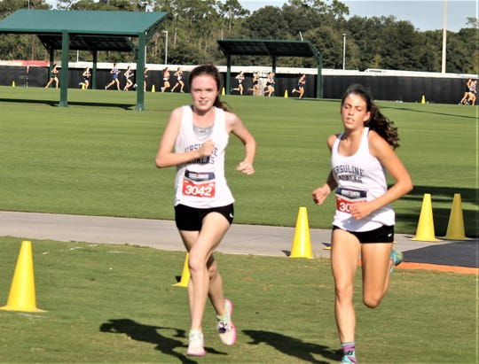 Ursuline's Haley McLean (l) and Daphne Banino (r) finish first and second, respectively, in their race Oct. 11, 2019 at the Disney Cross Country Classic in Florida.