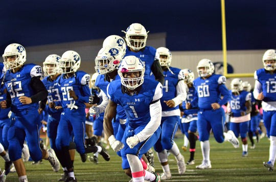 Dover senior Javon Peace (1) and the Senators take the field at Dover High Stadium Friday, October 10, 2019.