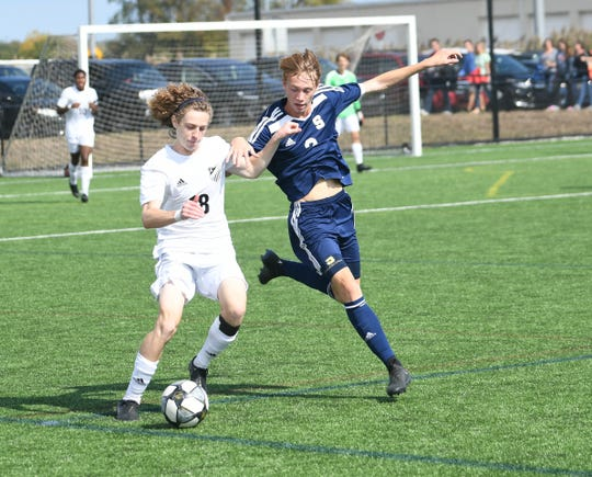 Appoquinimink's No. 18 Marcos Repolle attempts to keep the ball away from lurking Salesianum defender No. 2 Colton Steele Saturday afternoon.