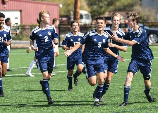 Salesianum's No. 5 Nathaniel Pilson celebrates with his teammates after his first-half goal against Appoquinimink.