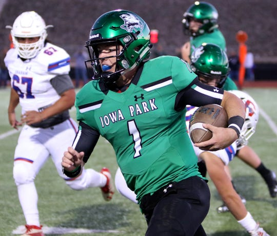 Iowa Park's Trent Green runs along the sideline against Graham Friday, Oct. 11, 2019, at Hawk Stadium in Iowa Park. The Hawks defeated the Steers 34-9.