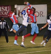 Hirschi's Stavonte Vaughn (12) and Antonio Wiley (3) had a Hail Mary pass broken up by Decatur's Jackson Carroll (20) late in the fourth quarter Friday night at Memorial Stadium. Decatur defeated Hirschi, 40-28.