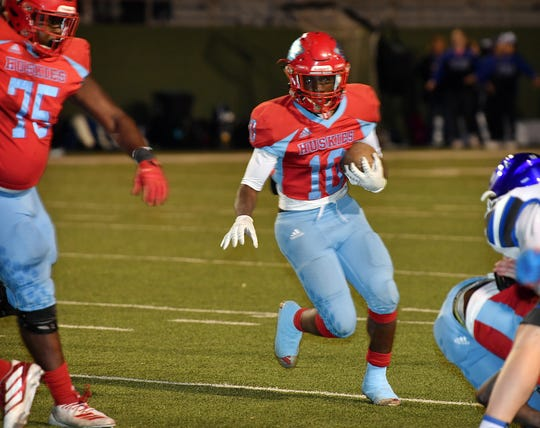 Hirschi running back KD Dorsey (10) finds a big hole as he runs the ball against Decatur Friday night at Memorial Stadium.