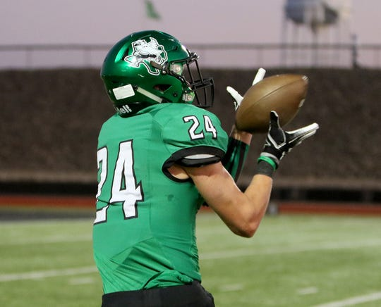 Iowa Park's Kaden Ashlock makes the catch and runs for a touchdown against Graham Friday, Oct. 11, 2019, at Hawk Stadium in Iowa Park. The Hawks defeated the Steers 34-9.