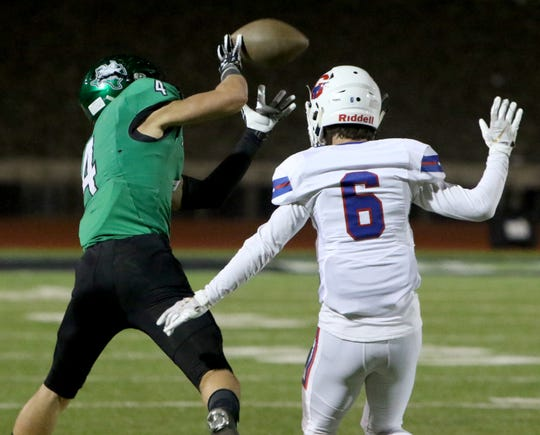 Iowa Park's Cirby Coheley makes the catch by Graham's Trey Overcash Friday, Oct. 11, 2019, at Hawk Stadium in Iowa Park. The Hawks defeated the Steers 34-9.