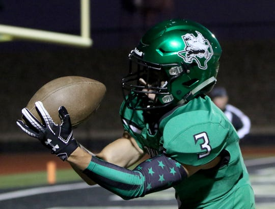 Iowa Park's Slayton Ochoa catches the pass for a touchdown against Graham Friday, Oct. 11, 2019, at Hawk Stadium in Iowa Park. The Hawks defeated the Steers 34-9.