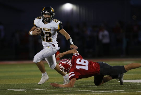 Tri-Valley's Blake Sands sheds a Sheridan defender Friday night in Thornville. The Scotties beat the Generals 38-21.
