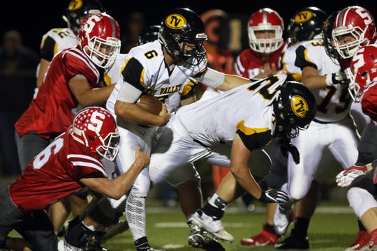Tri-Valley's Aidan Fritter looks for running room against the Sheridan defense during a 38-21 win on Oct. 11 at Paul Culver Jr. Stadium. Fritter's all-around play will likely be a key factor down the stretch as the Scotties make a playoff push.