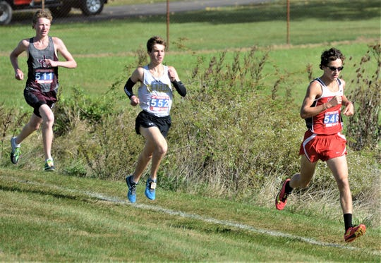 Sheridan junior William Wilke leads Tri-Valley senior Ryan Meadows and John Glenn sophomore Chris Tooms during the boys race of the MVL Cross Country Championships on Saturday at Foxfire. Wilke won the race in 15:27.