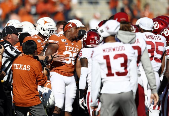 Texas and Oklahoma scuffle at midfield before kickoff at the 2019 AT&T Red River Showdown at Cotton Bowl.