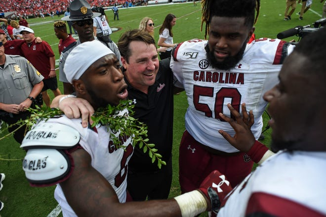 South Carolina coach Will Muschamp, center, celebrates with his players after defeating Georgia last season.