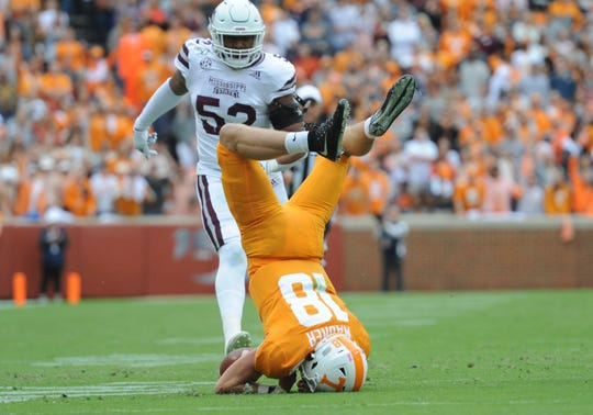 Tennessee Volunteers quarterback Brian Maurer is up ended by the Mississippi State Bulldogs during the second quarter at Neyland Stadium in Knoxville.