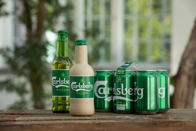 Danish brewer Carlsberg says it is developing a paper beer bottle made from sustainably sourced wood fibers.