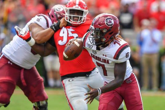 South Carolina Gamecocks quarterback Dakereon Joyner runs against the Georgia Bulldogs  during the second half at Sanford Stadium in Athens, Ga.