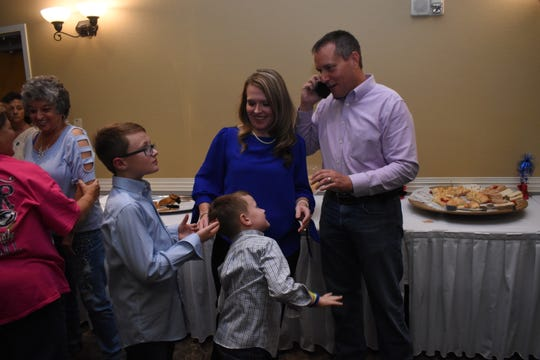 Rapides sheriff's candidate Kris Cloessner (right) and his family - wife Robyn and sons Jax and Kol - celebrate with supporters at the Best Western Inn & Suites Conference Center after he landed in the run-off with Mark Wood.