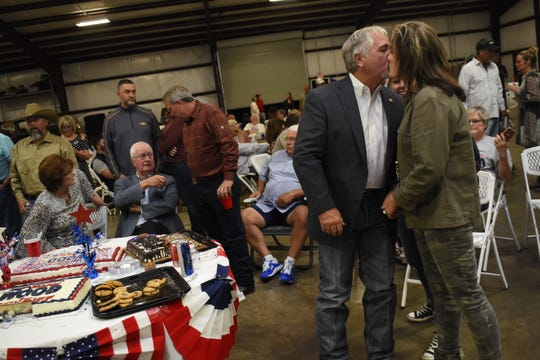 Rapides sheriff's candidate Mark Wood kisses his wife Tonya at an election watch party at Shelton & Grant Enterprises. Wood will be in a run-off election with Kris Cloessner.