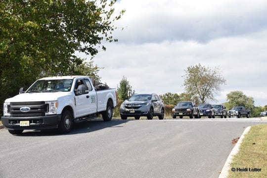 A convoy of trucks and cars brings pet supplies from Bayville Elks Lodge to Toms River Animal Shelter