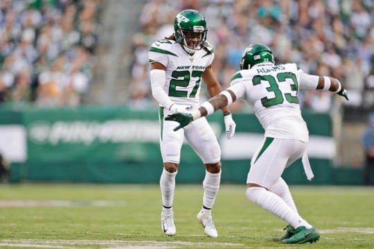 New York Jets' Darryl Roberts, left, and Jamal Adams celebrate during the first half of an NFL football game against the Dallas Cowboys, Sunday, Oct. 13, 2019, in East Rutherford, N.J.