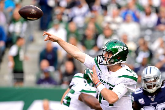Sam Darnold (14) of the New York Jets attempts a pass against the Dallas Cowboys during the first quarter at MetLife Stadium on Sunday, Oct. 13, 2019 in East Rutherford, New Jersey.