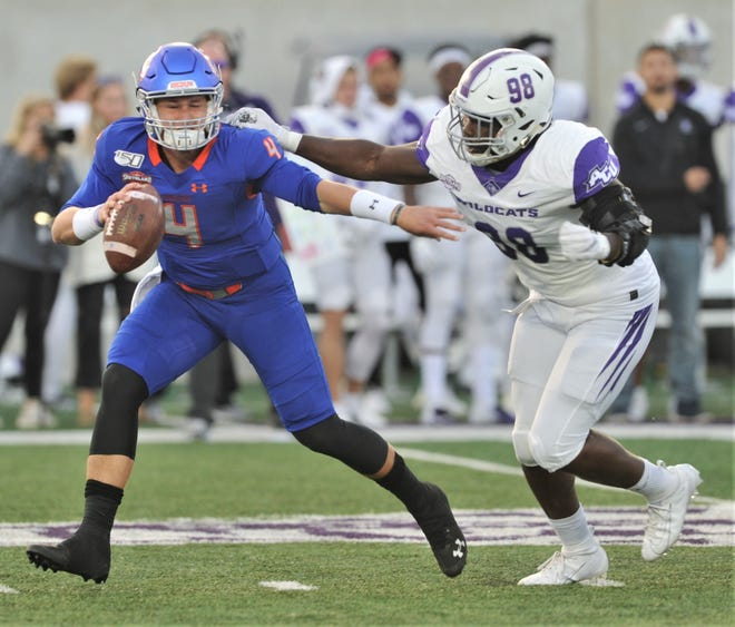 ACU's Temisan Kuyatsemi (98) puts pressure on Houston Baptist quarterback Bailey Zappe in the second quarter. The Wildcats beat HBU 45-20 in the Southland Conference game Saturday, Oct. 12, 2019, at Wildcat Stadium.