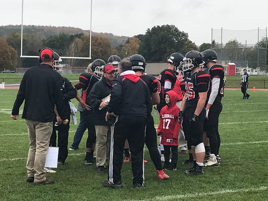 Newark Valley players gather during a timeout during Saturday's Section 4 Football Conference Division III game against visiting Dryden. The Cardinals won, 44-12.